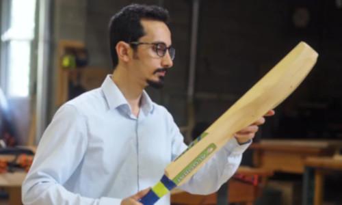 Sadegh Mazloomi holding a bat